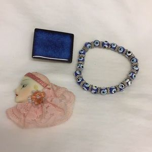 Broaches and bracelet